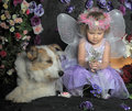 Little girl with wings and a dog portrait of her butterfly her Stock Photos