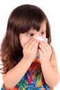 Little girl wiping nose with tissue Royalty Free Stock Images