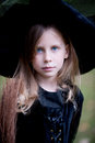 Little girl in witch costume with broom Stock Images