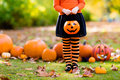 Little girl in witch costume on Halloween trick or treat Royalty Free Stock Photo