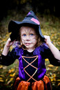 Little girl in witch costume silly with face painted Stock Photography