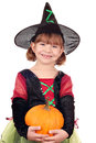 Little girl witch with pumpkin halloween happy Royalty Free Stock Photos