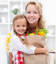 Little girl and woman with the groceries Royalty Free Stock Photo
