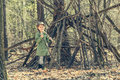 Little girl in the wood near  hut Royalty Free Stock Photo
