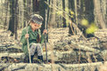 Little girl in the woods sitting on a stump Royalty Free Stock Photo