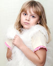 Little girl wraps up in white fluffy fur vest Royalty Free Stock Images