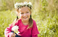 Little girl in wreath of flowers Stock Photography