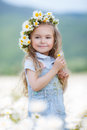 Little girl in a wreath of white daisies Royalty Free Stock Photo