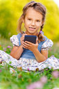 Little girl writes stylus on device Stock Photos