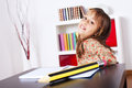 Little girl writing with a giant pencil Royalty Free Stock Photography