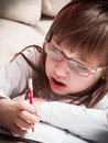 Little girl writing in her notebook Royalty Free Stock Photo