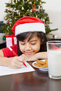 Little girl writing letter to santa Royalty Free Stock Photography