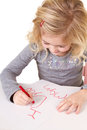 Little girl writting I love you mom Stock Image
