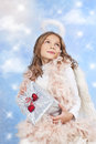 Little girl with xmas gift in front of starlights Royalty Free Stock Image