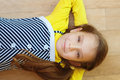Little girl in yellow dress lying Royalty Free Stock Photos