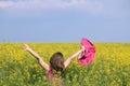 Little girl on yellow flower field Royalty Free Stock Photo