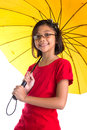 Little girl and yellow umbrella ix malay asian with over white background Royalty Free Stock Image