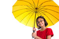 Little girl and yellow umbrella viii malay asian with over white background Royalty Free Stock Photo