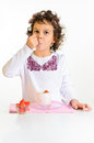 Little girl, yoghurt and strawberry Stock Image