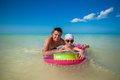 Little girl with young father on an air mattress in the sea this image has attached release Stock Image
