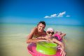Little girl with young father on an air mattress in the sea this image has attached release Royalty Free Stock Photos