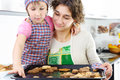 Little girl young mother baked cookies Stock Photos