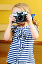 Little girl young photographer holding a retro rangefinder camera Stock Image
