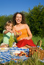 Little Girl and Young Women keeps in hand fruits Royalty Free Stock Photo