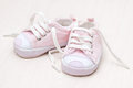 Little girlie baby shoes on a wooden floor Stock Photo