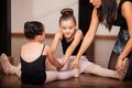 Little girls in a ballet class two warming up and getting instructions by their dance instructor dance academy Stock Photos