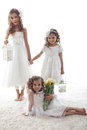 Little girls beautiful children wearing flower girl dresses posing with the bouquet of spring tulips Stock Photography