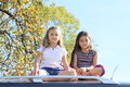 Little girls on a car barefoot kids sitting silver with tree behind Royalty Free Stock Photo