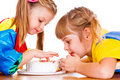 Little girls eating cake Stock Images