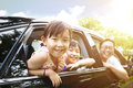 Little girls with family sitting in the car happy girl Stock Photos