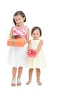 Little girls giving presents isolated Stock Photo