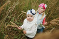 Little girls in high grass portrait Royalty Free Stock Photo