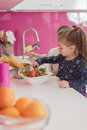 Little girls in the kitchen cooking Royalty Free Stock Image