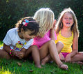 Little girls in nature portrait of cheerful a meadow Royalty Free Stock Photos