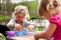 Little girls playing outdoors Royalty Free Stock Photo