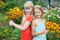 Little girls show ok in garden Stock Photography