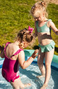 Little girls in swimming pool two cute having fun at the backyard Royalty Free Stock Photos