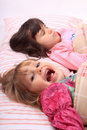 Little girls waking up Royalty Free Stock Image
