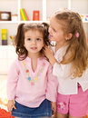 Little girls whispering secrets Royalty Free Stock Images