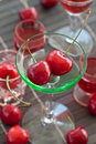 Little glass with fresh cherries green Royalty Free Stock Photography