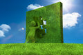 Little green character resolving a puzzle Royalty Free Stock Photo