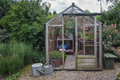 Little greenhouse in the garden. Royalty Free Stock Photo