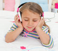 Little gril listening to music with headphones Royalty Free Stock Photo