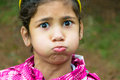 Little gypsy girl child holding breath funny portrait Royalty Free Stock Photo