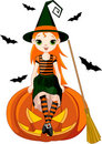 Little Halloween Witch on pumpkin Stock Image