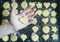 stock image of  HAND WITH COOKIE HEART ON TRAY_